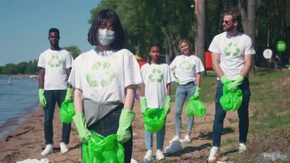 Eco Activists and Volunteers are Fighting for the Preservation of Nature Volunteers are Standing and
