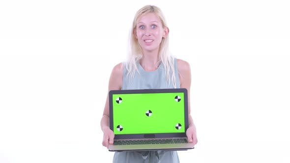 Thumbnail for Happy Young Beautiful Blonde Woman Showing Laptop and Looking Surprised