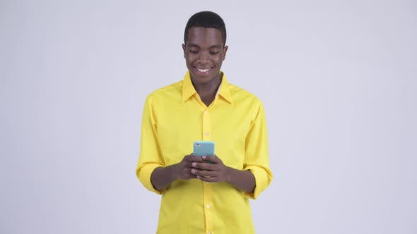 Thumbnail for Young Happy African Businessman Using Phone