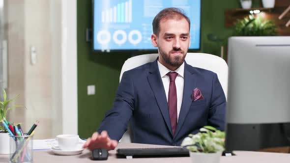 Thumbnail for Smiling Sales Person in Business Suit Working on Computer