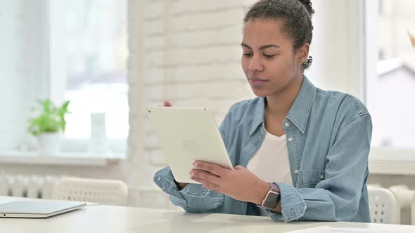 Thumbnail for Young African Woman Using Tablet in Office