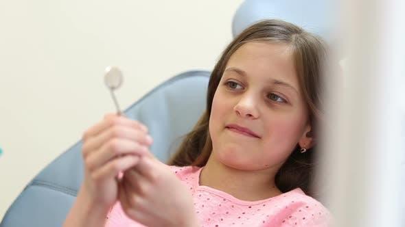 Thumbnail for Close up of cute girl having a dental checkup