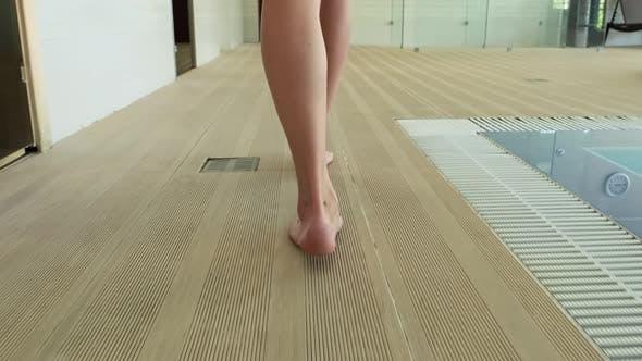 Thumbnail for Young beautiful woman in swimwear body, bikini walking near swimming pool in hotel spa