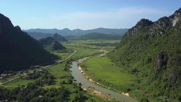 Thumbnail for Motion To Fields By River Running in Valley Between Hills