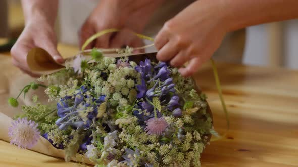 Cover Image for Florists Wrapping Exquisite Wildflower Bouquet Together