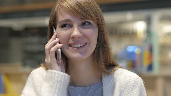 Young Woman Talking on Phone, Attending Phone Call