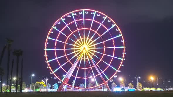 Thumbnail for Ferris Wheel Spins at Night with Colored Lights