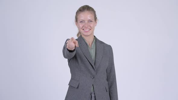 Thumbnail for Young Happy Blonde Businesswoman Pointing at Camera