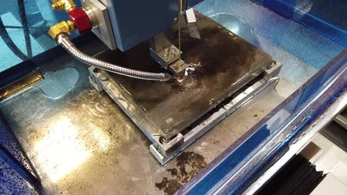 Electroerosive CNC EDM Machine in the Process.