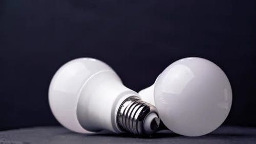 LED light bulbs on table with dark background