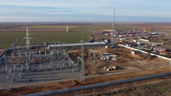 Aerial Footage of the Huge Wind Power Plant Construction Site,
