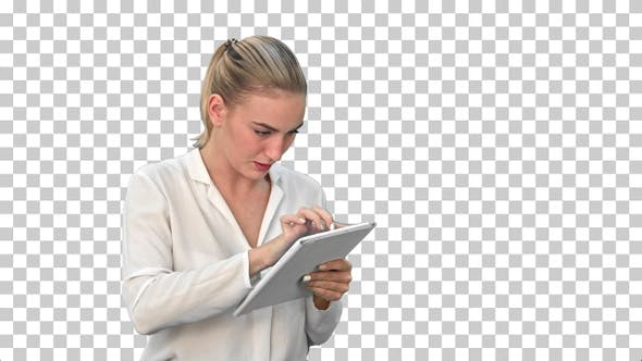 Businesswoman standing with digital tablet, Alpha Channel