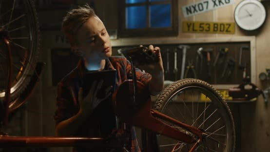Thumbnail for Teen Boy Repairs Bicycle