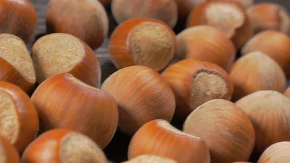 Thumbnail for Hazelnut shells on wooden table dolly 4K 3840X2160 UHD footage - Hazelnuts on table close-up dolly s