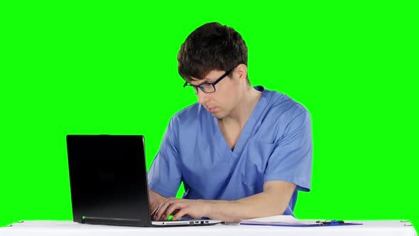 Thumbnail for Young Male Doctor Working on Laptop. Green Screen
