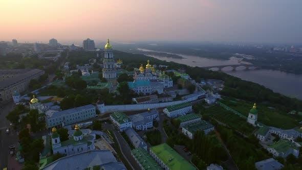 Thumbnail for Aerial View Kiev Pechersk Lavra on Green Hills at Evening Sunset Landscape