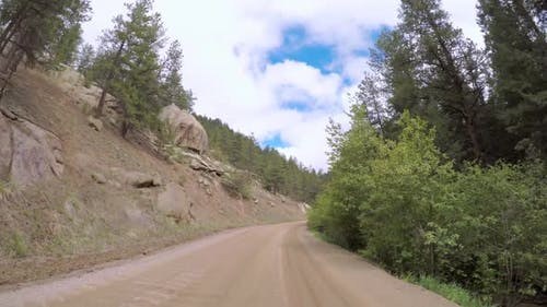 POV point of view - Driving on dirt road in the mountains in Western Colorado.