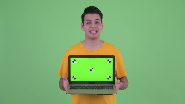 Thumbnail for Happy Young Multi Ethnic Man Talking While Showing Laptop