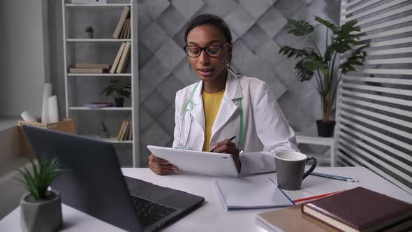 Woman Doctor Consulting Patient Via Internet