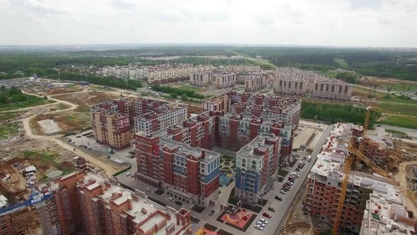 Cover Image for Flying Over Housing Complex with New Built and Unfinished Buildings, Russia