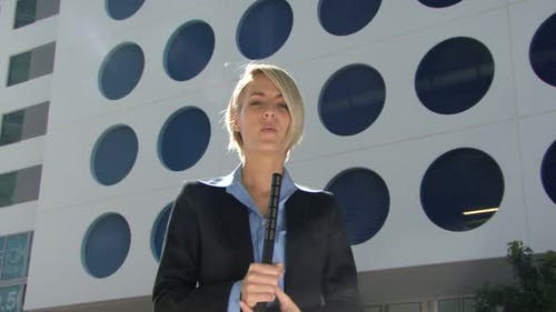 Female reporter talking to camera