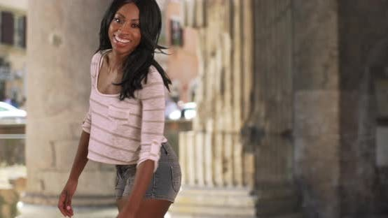 Happy energetic black female spins for camera at Pantheon in Rome