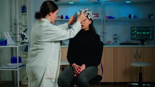 Neurological Researcher in Special Medicine Explaning Treatment