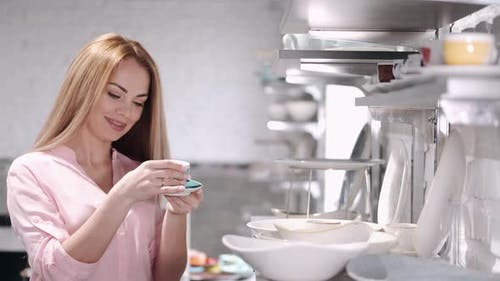 The Pretty Housewife Is Choosing China Crockery at the Kitchen Ware Store
