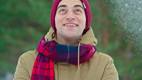 Thumbnail for Man Enjoying Snowfall
