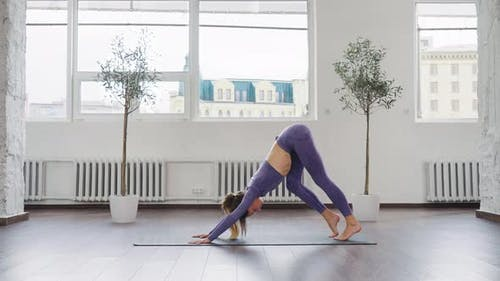 Yogi Woman Carrying Out Poses in Studio