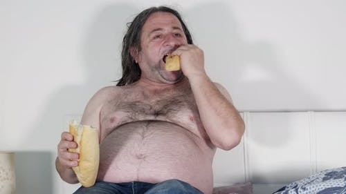 Fat Man Eating In Bed Watching Television 1