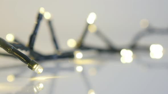 Thumbnail for Close-up of blinking Christmas decoration   4K 2160p 30fps UltraHD footage - String with  sparkling