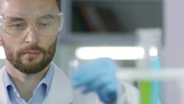 Thumbnail for Male Caucasian Scientist Working in Lab