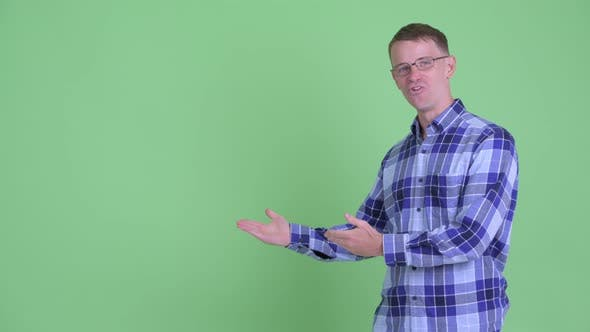 Cover Image for Portrait of Happy Hipster Man Talking While Showing Something
