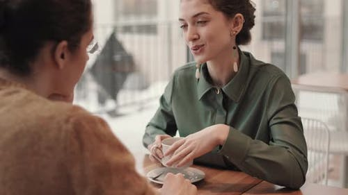 Woman Meeting with Boyfriend in Coffee House