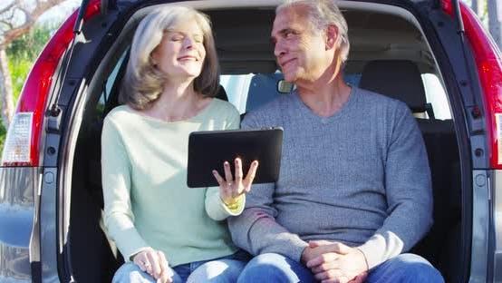 Thumbnail for Elderly couple using tablet deciding where to go