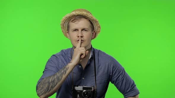 Thumbnail for Portrait of Man Tourist Photographer Showing To Be Quiet. Chroma Key