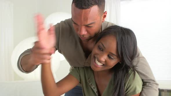 Thumbnail for African boyfriend being silly with girlfriend