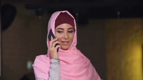 Attractive Muslim Woman Talking at Mobile Phone