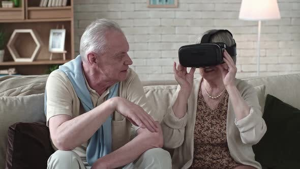Thumbnail for Laughing Elderly Woman in VR Headset