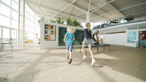 Children Running Towards Fish Tank in Oceanarium