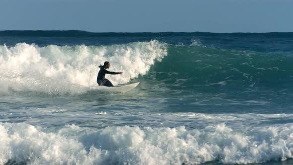 Surfer rides wave, Hawaii