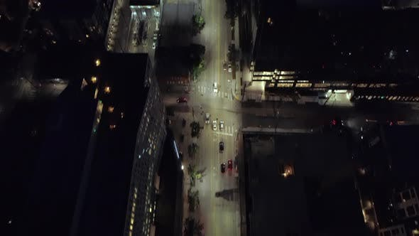 Thumbnail for Epic City Aerial At Night Panning Lit Street To Skyline Skyscraper Building Lights