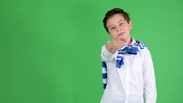 Thumbnail for Young Handsome Child Boy Points To Camera - Green Screen - Studio