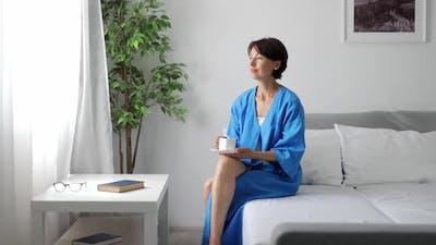 Woman Drinking Coffee in Morning
