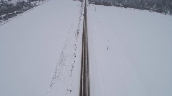 Winter Road in the Field