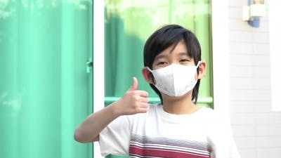 Cute Asian Child Wearing Face Mask