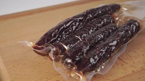 Traditional Spanish chorizo sausage in a polyethylene package.
