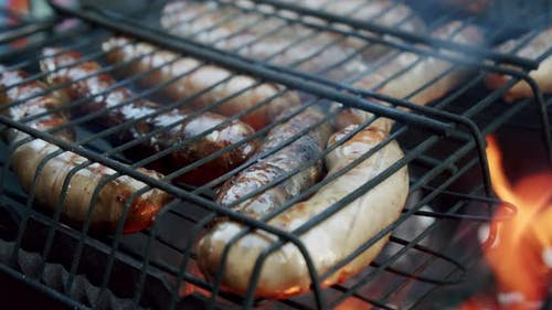 Sausages Are Fried on an Open Fire, Close Up Slow Motion