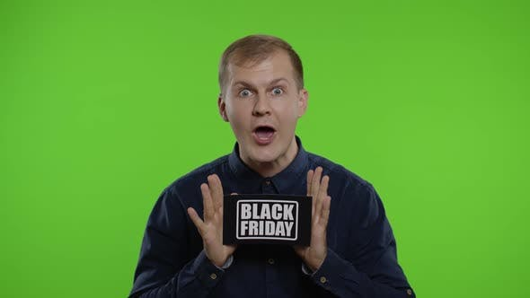 Thumbnail for Excited Man Showing Black Friday Inscription Note, Smiling Looking Satisfied with Low Prices